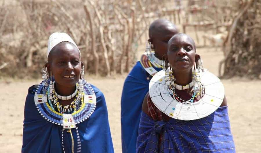 Maasai women in traditional costume on great migration safari trip to africa