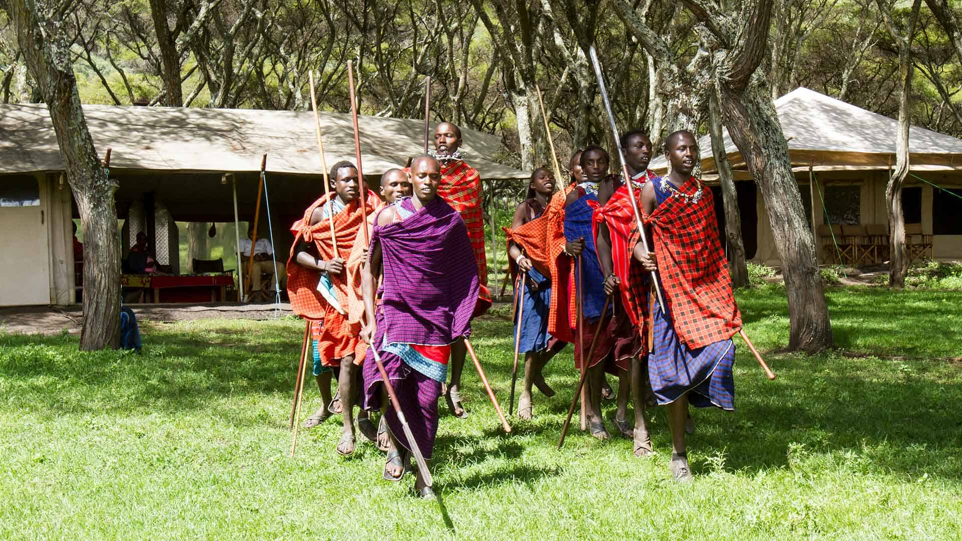 young Maasai men performing a dance on great migration safari to Tanzania